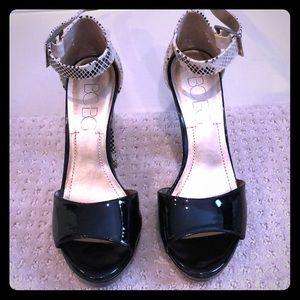 BCBG black snakeskin heels